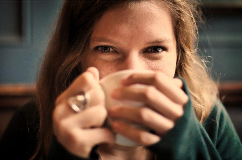 A woman drinking coffee.